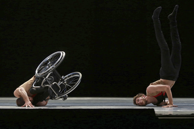 "Dancers from the United Kingdom's Candoco Dance Company perform a piece called ""Let's Talk About Dis"" at the Guanajuato State Auditorium during the 43rd edition of the Cervantino International Festival in Guanajuato, Mexico, Sunday, October 11, 2015. The Candoco Dance Company mixes disabled and non-disabled dancers in many of its choreographies. (Photo by Mario Armas/AP Photo)"