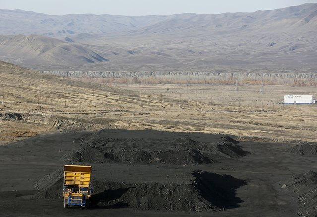A BelAZ dump truck of the Mining Tuva Energy Industrial Corporation unloads coal at the Zapadny coal opencast colliery of the Elegestskoye coal deposit outside the Ust-Elegest village in Tuva region, Southern Siberia, Russia, October 10, 2015. The Elegestskoye coal deposit is part of the Ulug-Khemsky coal field, with the area of 2,300 square kilometres and general resources of 14,2 billion tons of coal, in Central Tuva Basin, according to local media. (Photo by Ilya Naymushin/Reuters)