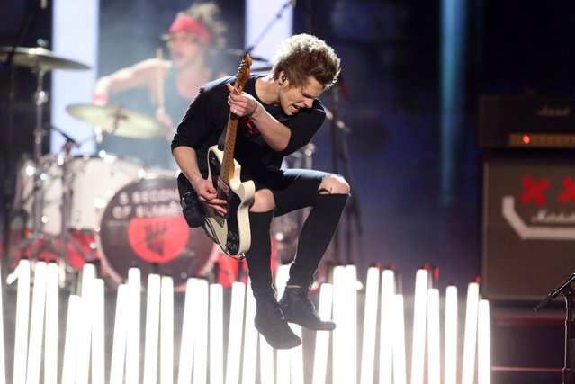Luke Hemmings of the group 5 Seconds of Summer performs on stage at the 42nd annual American Music Awards at Nokia Theatre L.A. Live on Sunday, November 23, 2014, in Los Angeles. (Photo by Matt Sayles/Invision/AP Photo)