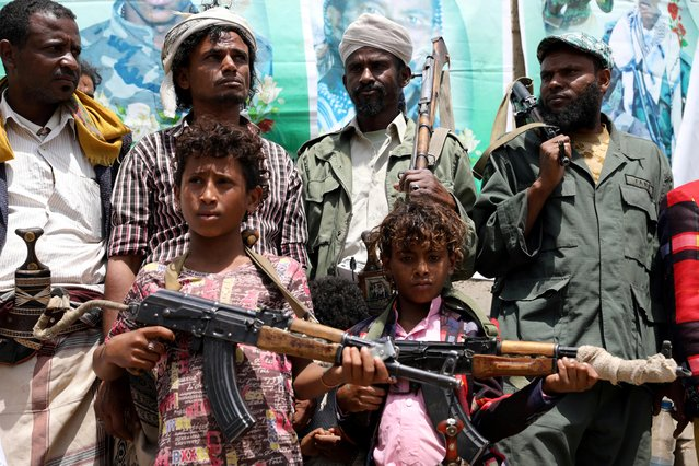 Boys from the Muhamasheen (marginalized) community hold weapons as they attend a pro-Houthi gathering at their neighborhood in Sanaa, Yemen on July 15, 2020. (Photo by Khaled Abdullah/Reuters)