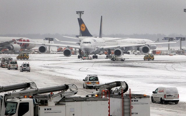 Lufthansa airplanes are seen on the snow covered ground of the airport in Frankfurt am Main, western Germany, on March 12, 2013 as the Europe's third-busiest hub was able to re-open one runway for takeoffs only on the afternoon, after being forced to close completely due to heavy snow. (Photo by Daniel Roland/AFP Photo)