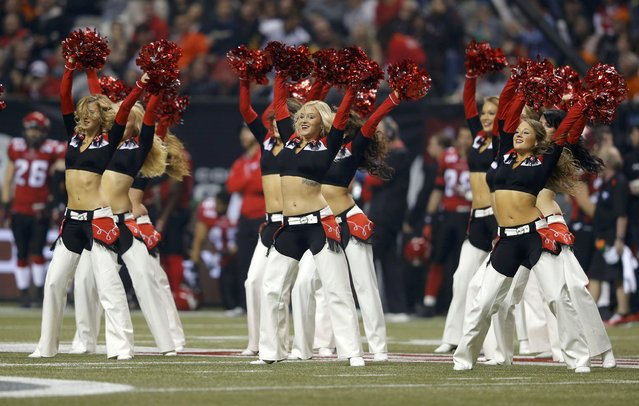 Calgary Stampeders cheerleaders perform during the CFL's 102nd Grey Cup football championship against the Hamilton Tiger Cats in Vancouver, British Columbia, November 30, 2014. (Photo by Todd Korol/Reuters)