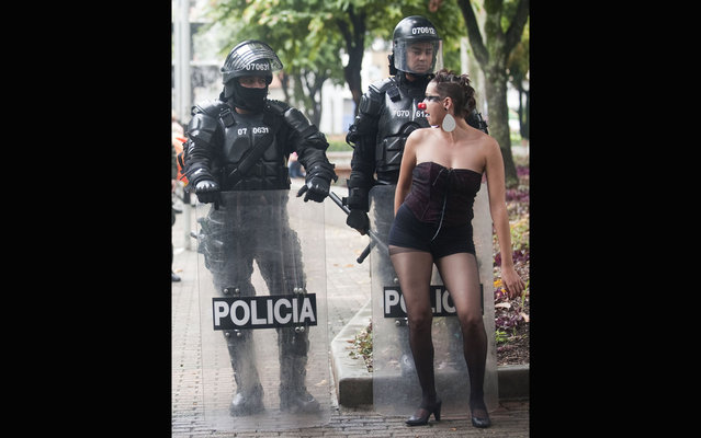 Students perform by riot police during a protest in Medellin, Antioquia department, Colombia on March 21, 2013, demanding a better and free education and an alternative university reform. (Photo by Raul Arboleda/AFP Photo)