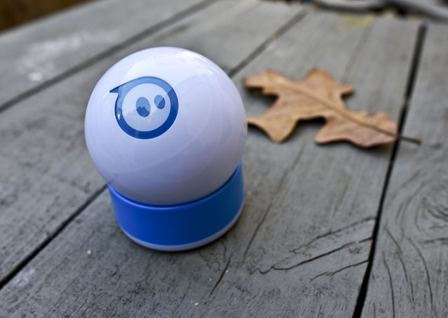 This Wednesday, December 10, 2014 photo shows the Sphero robotic ball, in Decatur, Ga. The Sphero is controlled with an app on a smartphone and can roll, glow, spin, shake and dance, all under the direction of the user. (Photo by Ron Harris/AP Photo)
