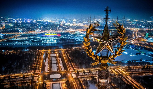 An aerial view taken with a drone in Moscow on January 27, 2018 shows a star on top of the Moscow State University, Luzhniki Stadium and the Moskva River. (Photo by Dmitry Serebryakov/AFP Photo)