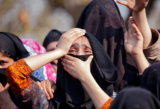 Women wail as they watch the body of Zubair Ahmed Turay, a suspected militant, being carried away during his funeral procession in south Kashmir's Shopian district April 1, 2018. (Photo by Danish Ismail/Reuters)