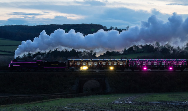 The S15 class steam locomotive 506 pulls the world's first digital LED train, created using thousands of fully controllable colour mixing LED lights, as it makes it's way from Alresford Station to Ropley station in Hampshire during a preview of Steam Illuminations at Watercress Line, which opens to the public on Friday December 4, 2020. (Photo by Andrew Matthews/PA Images via Getty Images)