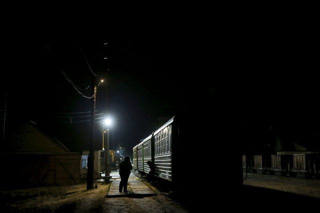 Local residents await the departure of a train to the town of Alapayevsk, in Sankin, Sverdlovsk region, Russia, October 15, 2015. (Photo by Maxim Zmeyev/Reuters)