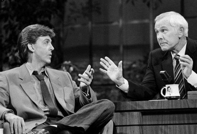 "Singer Paul McCartney gestures as he chats with Johnny Carson during the taping of the ""Tonight Show"" at the NBC Studios in Burbank, Calif., October 24, 1984.  (Photo by Nick Ut/AP Photo)"