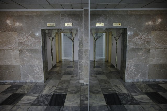 The entrance to toilets is reflected in a mirror in the lobby of Yanggakdo International Hotel in Pyongyang, North Korea, October 11, 2015. Foreign tourists to Pyongyang usually stay at the hotel. (Photo by Damir Sagolj/Reuters)