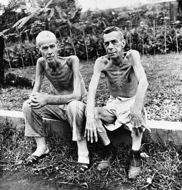 They're free at last, but the appearance of Lee Roger (left), 68, a retired Cavite Navy Yard employe, and John C. Todd, 63, a miner on February 23, 1945, bears witness to the rigors of their life in the Japanese interment camp at Santo Tomas University, Manila, P.I.   Rogers' weight dropped from 145 pounds to 90 during his internment and Todd's from 178-102.  This photo made by Life Photographer Carl Mydans for the wartime still picture pool. (Photo by AP Photo/Pool)
