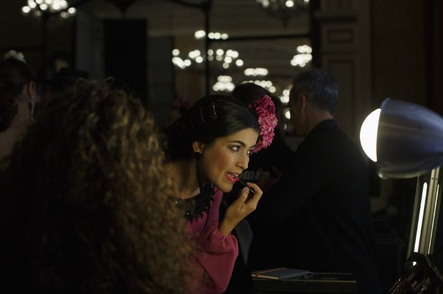 "A model applies lipstick backstage during the ""We Love Flamenco"" fashion show in the Andalusian capital of Seville January 14, 2015. The show will run until January 18. (Photo by Marcelo del Pozo/Reuters)"