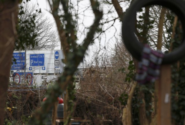 Road signs close on the approach road to Heathrow airport can be seen from the anti-Heathrow expansion activists', 'Grow Heathrow' protest camp, in the village of Sipson near to Heathrow Airport, west London Britain December 7, 2015. (Photo by Peter Nicholls/Reuters)