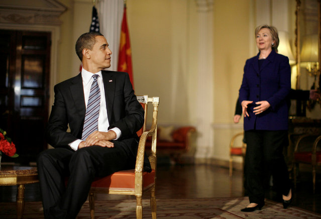 U.S. President Barack Obama looks over his shoulder as U.S. Secretary of State Hillary Clinton walks in to a meeting with China's President Hu Jintao at Winfield House, the U.S. Ambassador's residence, in London April 1, 2009. (Photo by Jason Reed/Reuters)