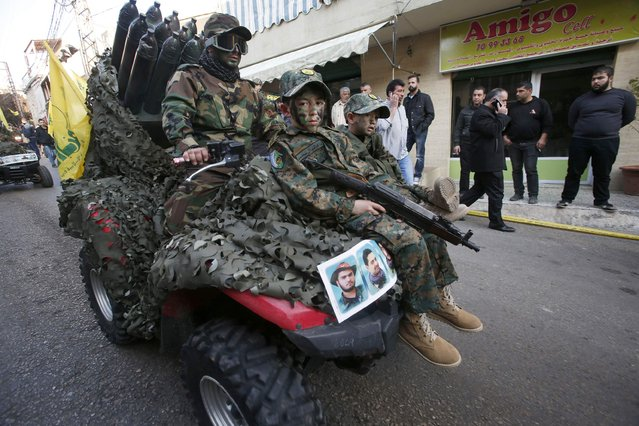 Ahmad, the son of Lebanon's Hezbollah commander Mohamad Issa, known as Abu Issa, rides a vehicle as he carries his father's rifle during his funeral in Arab-Salim, south Lebanon January 20, 2015. U.N. peacekeepers stationed in the Golan Heights along the Syrian-Israeli border observed drones coming from the Israeli side before and after an airstrike that killed several top Hezbollah figures, the U.N. said Monday. (Photo by Ali Hashisho/Reuters)