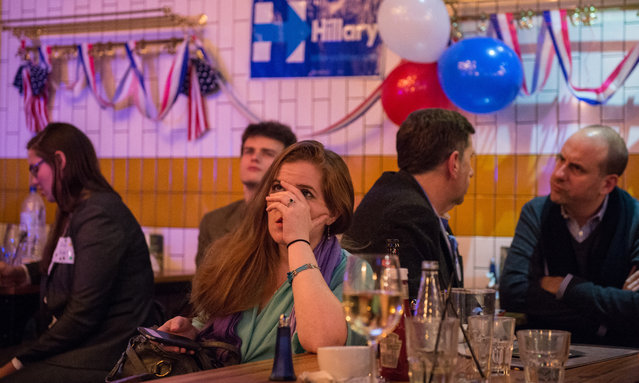 American Democratic Party supporters react to the news that Donald Trump has won the state of Florida at the Democrats Abroad election night party at Marylebone Sports Bar and Grill on November 9, 2016 in London, England. Americans go to the polls today to choose between Trump and Democrat Hillary Clinton for president. (Photo by Chris J. Ratcliffe/Getty Images)
