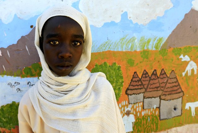 Mozdalifa Abaker Omer, a 5th grader at the Alsalam 2 School for Girls at Aboshok camps for the internally displaced persons poses for a photograph in El-Fasher, North Darfur, Sudan, November 17, 2015. Born in the camp, 12 years old Omer wishes to be a doctor in her adulthood. (Photo by Mohamed Nureldin Abdallah/Reuters)