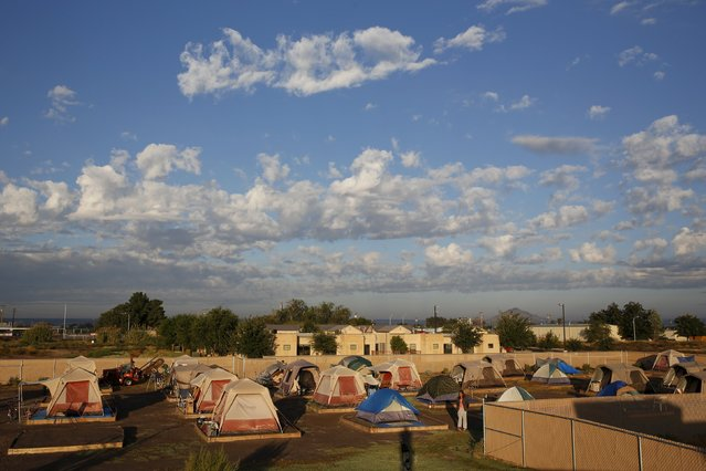 "Clouds pass above Camp Hope in Las Cruces, New Mexico October 6, 2015. Camp Hope describe themselves as ""alternative transitional living project for the homeless"". Around 50 people live at the camp. At homeless encampments from Seattle, Washington state to Las Cruces, New Mexico, residents live away from the dangers of life on the streets, saying the stability helps them work towards their goals. Despite a shortage of affordable housing for the poor and budget constraints on social welfare programmes, many U.S. cities have clamped down on tent cities in the past few years. (Photo by Shannon Stapleton/Reuters)"