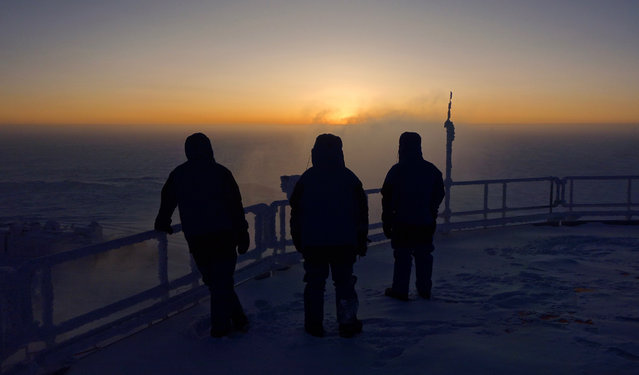After four months with seeing the Sun rise above the horizon the crew of Concordia research station welcome its return from the rooftop on August 12, 2016. During the Antarctic summer some 60 scientists live and work on the base conducting research on the icy plateau 3200 m above sea level. When winter comes, the skeleton crew of up to 15 keep the base running and fend for themselves for nine months – no help can be flown in as temperatures drop to –80ºC. Preparing for exploration of our Solar System, ESA runs life-science experiments on the crew as they adapt to life in these harsh conditions. (Photo by Van den Berg/ESA/IPEV)