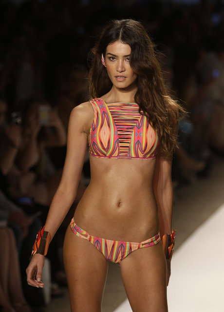 A model walks the runway during the Cia.Maritima show at the Mercedes-Benz Fashion Week Swim 2014, Saturday, July 20, 2013, in Miami Beach, Fla. (Photo by Lynne Sladky/AP Photo)