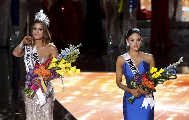 Miss Philippines Pia Alonzo Wurtzbach (R) waits with Miss Colombia Ariadna Gutierrez onstage after Miss Colombia was initially crowned Miss Universe during the 2015 Miss Universe Pageant in Las Vegas, Nevada, December 20, 2015. Miss Colombia was announced as the winner but host Steve Harvey said he made a mistake when reading the card. Miss Philippines Pia Alonzo Wurtzbach is the actual winner. (Photo by Steve Marcus/Reuters)