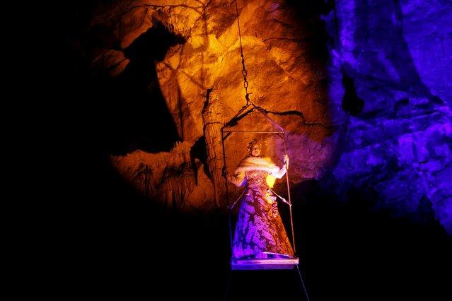 Actor performs the living Nativity biblical scenes in Postojna cave in Postojna, Slovenia, December 22, 2015. (Photo by Srdjan Zivulovic/Reuters)