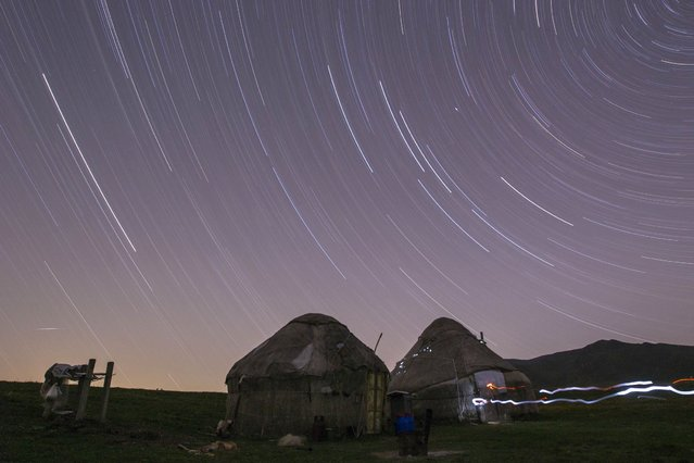 Star trails form over yurts, traditional nomad felt tents, in a long exposure picture on the mountainous Assy plateau, on August 5, 2013. (Photo by Shamil Zhumatov/Reuters)