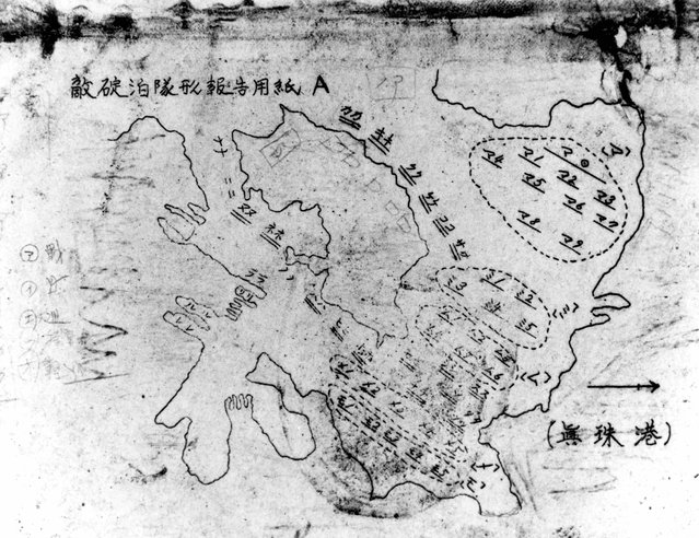 """A chart identifying ship mooring locations and entitled (at upper left) """"Report on positions of enemy fleet at anchorage"""", is seen after it was recovered from a Japanese aircraft that was downed during the attack on Pearl Harbor, Hawaii, U.S. December 7, 1941. (Photo by Reuters/U.S. Navy/National Archives)"""