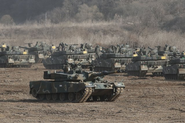"""A South Korean army's K1A2 tank moves during a military exercise in Paju, South Korea, near the border with North Korea, Wednesday, March 17, 2021. In North Korea's first comments directed at the Biden administration, Kim Jong Un's powerful sister Kim Yo Jong on Tuesday warned the United States to """"refrain from causing a stink"""" if it wants to """"sleep in peace"""" for the next four years. (Photo by Ahn Young-joon/AP Photo)"""