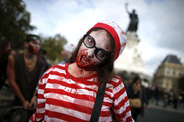 A woman dressed as a zombie participates in a Zombie Walk procession in the streets of Paris October 12, 2013. (Photo by Benoit Tessier/Reuters)