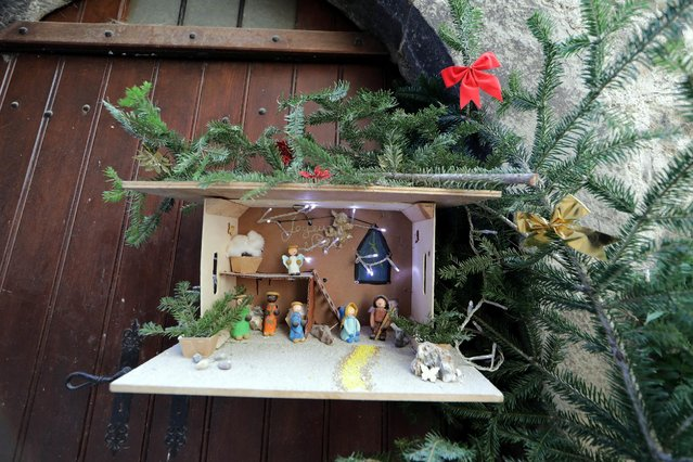 A Nativity scene is seen in front of a house in the medieval mountain village of Luceram as part of Christmas holiday season, France, December 15, 2016. (Photo by Eric Gaillard/Reuters)