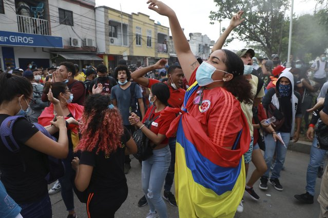 Anti-government demonstrators protest against the FIFA World Cup Qatar 2022 qualifying soccer match between Argentina and Colombia that will be played in Barranquilla, Colombia, Tuesday, June 8, 2021. (Photo by Jairo Cassiani/AP Photo)