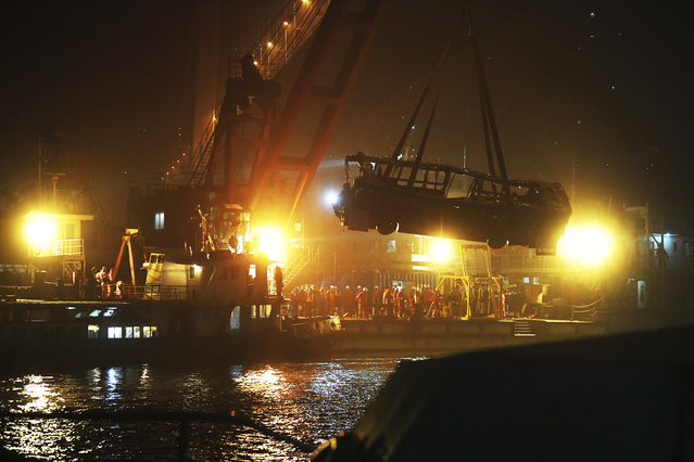 In this Oct. 31, 2018, file photo released by China's Xinhua News Agency, a bus is lifted out of the Yangtze River by a floating crane in Wanzhou in southwestern China's Chongqing Municipality. Police said on Friday, Nov. 2, 2018, a brawl between a passenger and a bus driver was the cause of the bus plunging off a bridge and killing more than a dozen people in southwestern China on Sunday. (Photo by Wang Quanchao/Xinhua via AP Photo)