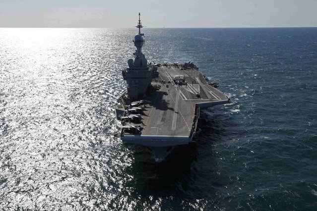 An aerial view of France's Charles de Gaulle aircraft carrier as it makes its way in the Gulf, January 28, 2016. (Photo by Philippe Wojazer/Reuters)