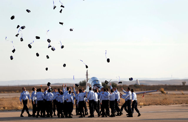 Israeli air force cadets toss their caps during a graduation ceremony for Israeli air force pilots at the Hatzerim air base in southern Israel December 29, 2016. (Photo by Amir Cohen/Reuters)