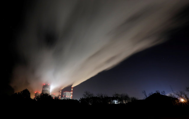 Smoke and steam billow from Belchatow Power Station, Europe's largest coal-fired power plant operated by PGE Group, at night near Belchatow, Poland on November 28, 2018. (Photo by Kacper Pempel/Reuters)