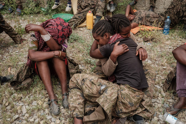 Captive Ethiopian female soldiers console each other upan their arrival to the Mekele Rehabilitation Center in Mekele, the capital of Tigray region, Ethiopia, on July 2, 2021. (Photo by Yasuyoshi Chiba/AFP Photo)