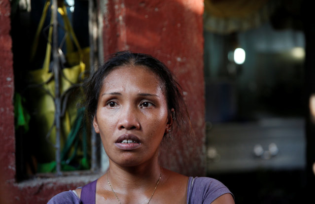Jona speaks to reporters at the entrance of her house near the coffin of her son Jonel Segovia, who was shot dead by suspected vigilantes at a house storing illegal narcotics, police said on Thursday, in Caloocan city, Metro Manila, in the Philippines December 29, 2016. (Photo by Erik De Castro/Reuters)