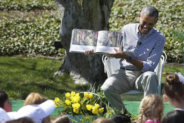 "U.S. President Barack Obama laughs as he reads the storybook ""Where the Wild Things Are"" during the annual Easter Egg Roll at the White House in Washington April 6, 2015. (Photo by Jonathan Ernst/Reuters)"