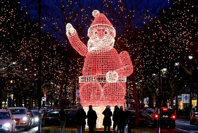 A Santa Claus figure is illuminated in Berlin. (Photo by Fabrizio Bensch/Reuters)