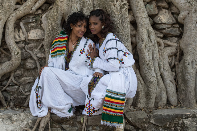Women pose for a photograph in traditional Ethiopian dress during the annual Timkat Epiphany celebration on January 19, 2017 in Gondar, Ethiopia. (Photo by Carl Court/Getty Images)