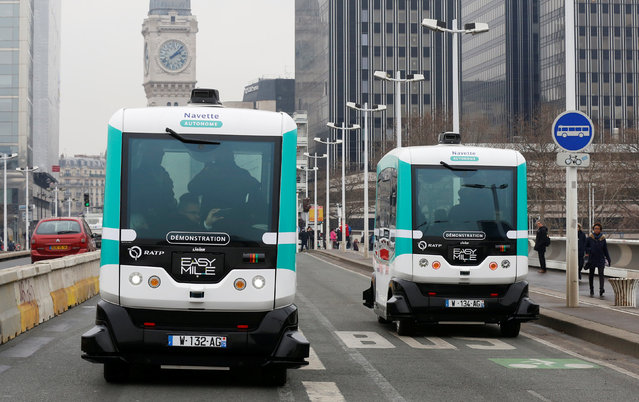 Two self-driving electric minibuses are seen on the 130-metre (142-yard) test route between Gare de Lyon and Austerlitz train stations, the first regular line opened by the Paris transport company RATP, in Paris, France, January 24, 2017. (Photo by Jacky Naegelen/Reuters)