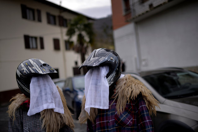 Revellers wear helmets and veils during carnival celebrations in Ituren, northern Spain January 30, 2017. (Photo by Vincent West/Reuters)