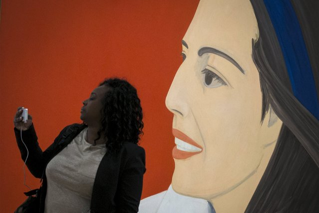 "A woman takes a selfie photo with the ""Red Smile"" by Alex Katz during the opening preview at The Whitney Museum of American Art in New York April 23, 2015. (Photo by Brendan McDermid/Reuters)"