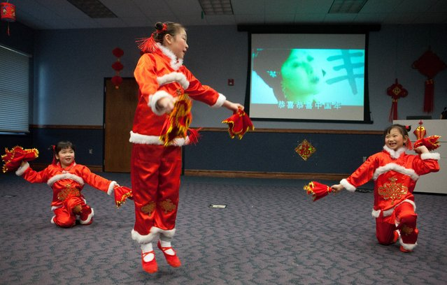 A group of girls perform a dance at the Chinese New Year celebration at Blum Union on the Missouri Western State University Campus in St. Joseph, Mo., Thursday, January 30, 2014. (Photo by Sait Serkan Gurbuz/AP Photo/St. Joseph News-Press)