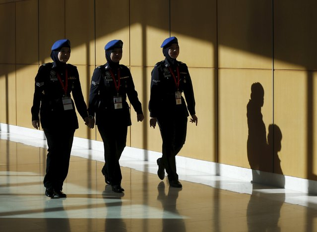 Police walk at the ASEAN summit in Kuala Lumpur, Malaysia, April 26, 2015. Malaysia is hosting the 26th ASEAN Summit from April 26 to April 27 in Kuala Lumpur and Langkawi. (Photo by Olivia Harris/Reuters)