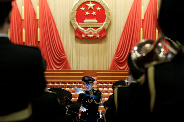 Military band members rehearse before the closing session of the National People's Congress (NPC) at the Great Hall of the People in Beijing, China March 15, 2019. (Photo by Thomas Peter/Reuters)