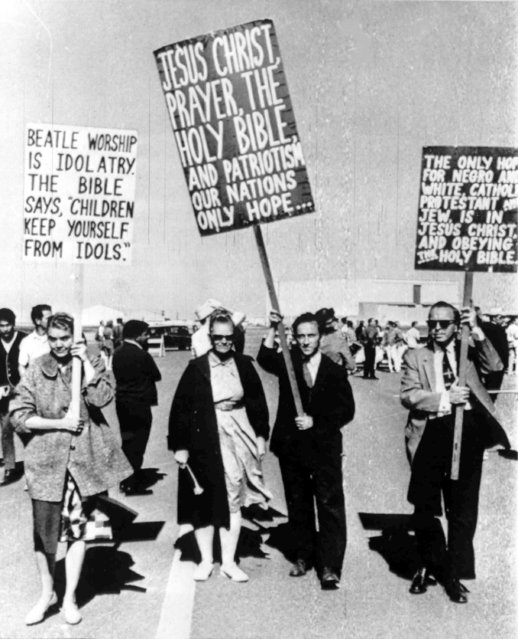 A group of protesters carrying signs march at San Francisco International Airport on Aug. 19, 1964, where the British pop group The Beatles are due to arrive to begin a tour of the U.S. (Photo by AP Photo)