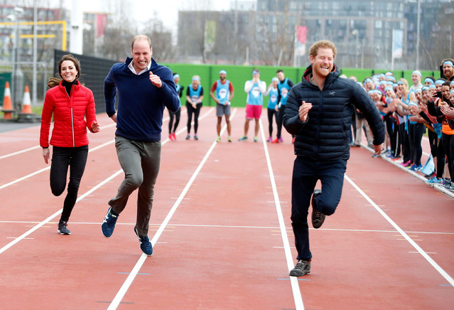 Britain's Prince William, second left, Kate, the Duchess of Cambridge, left, and Prince Harry take part in a relay race, during a training event to promote the charity Heads Together, at the Queen Elizabeth II Park in London, Sunday, February 5, 2017. (Photo by Alastair Grant/AP Photo)