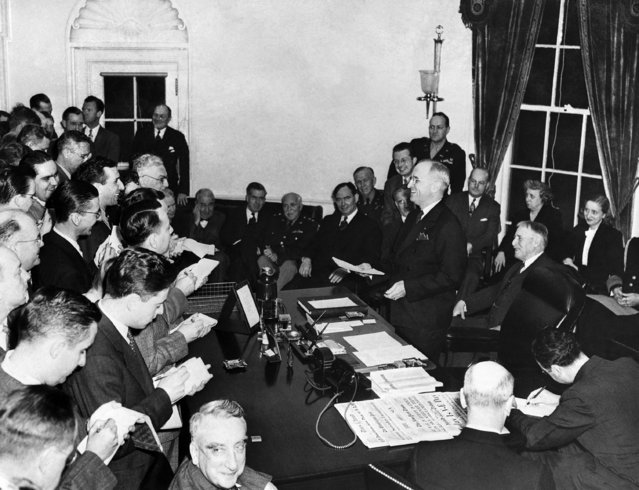 President Harry S. Truman smiles happily as he announces to the press the complete victory of the Allies over Germany, during a ceremony at the White House in Washington, D.C., May 8, 1945. Seated near the wall behind Truman are, left to right: Elmer Davis, Secretary Henry A. Wallace, Maj. Gen. Philip Fleming, Rep. (Photo by AP Photo)